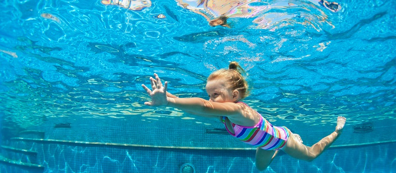 Child Jump Underwater Into Swimming Pool Blue Water
